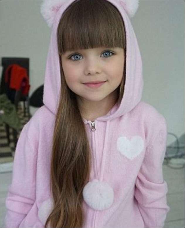 صوره اجمل طفلة في العالم , طفله تورتل القران الكريم